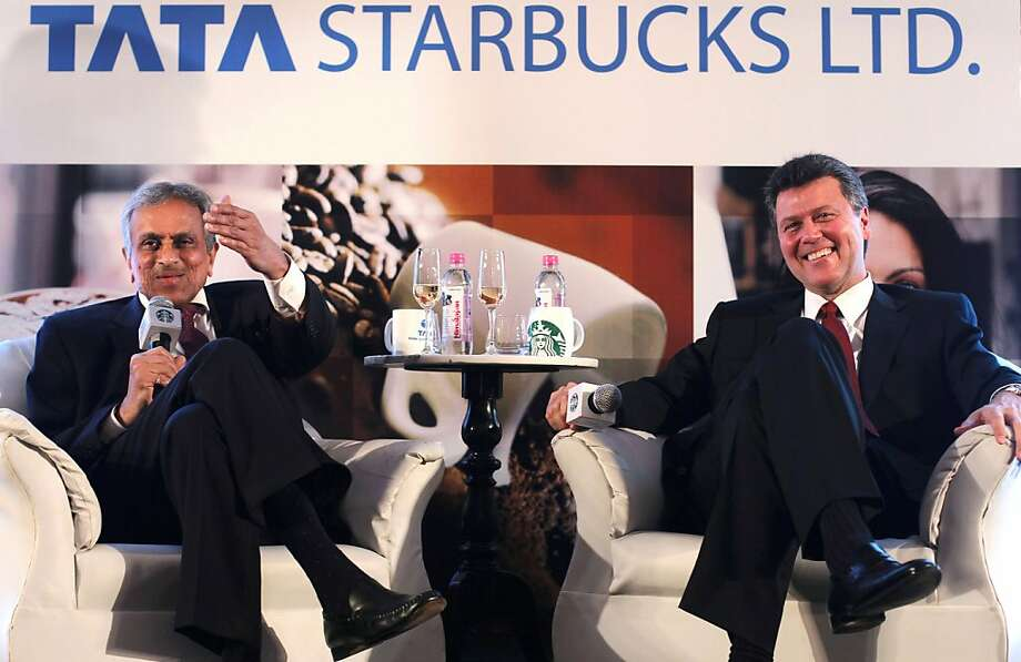 R.K. Krishna Kumar (left) of Tata Global and John Culver of Starbucks discuss the venture in January. Photo: Rafiq Maqbool, Associated Press