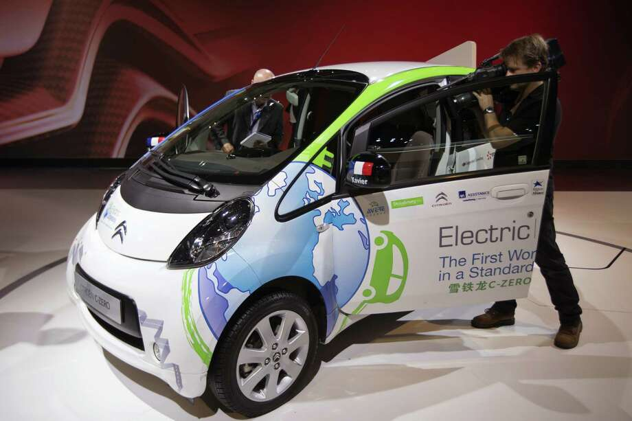 A Citroen CZero electric car sits on display at the Paris Motor Show on Sept. 28, 2012. It is one of many electric and hybrid cars featured at the show. Photo: JOEL SAGET, AFP/Getty Images / 2012 AFP