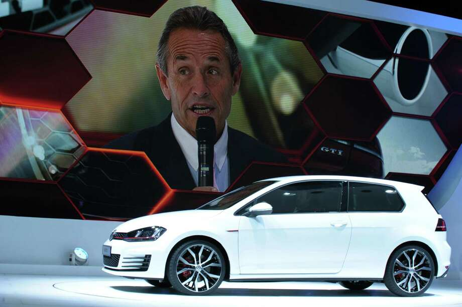 Motorsport legend Jacky Ickx (on screen) talks during the presentation of the Volkswagen Golf GTI on the stand of German carmaker Volkswagen on Sept. 27, 2012 at the Paris Motor Show. Photo: AFP, AFP/Getty Images / 2012 AFP