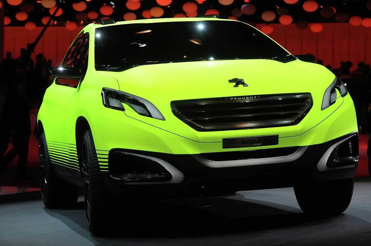 A Peugeot 2008 car sits on display at the Paris Motor Show on Sept. 27, 2012.