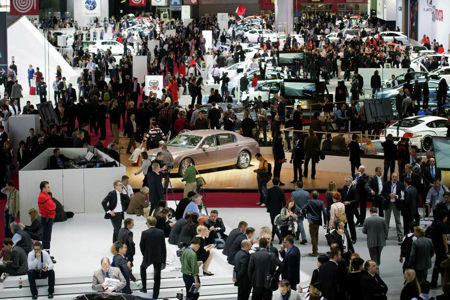 People visit stands during the press days ahead of the opening of the Paris Motor Show on Sept. 27, 2012. Photo: JOEL SAGET, AFP/Getty Images / 2012 AFP