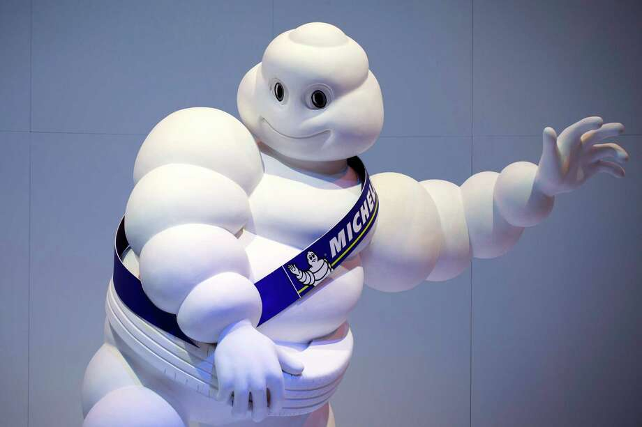 The Michelin Man hangs out at the  Paris Motor Show on Sept. 27, 2012. Photo: JOEL SAGET, AFP/Getty Images / 2012 AFP