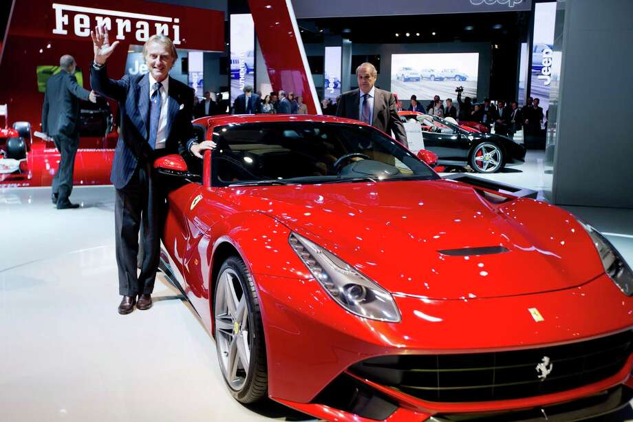 Ferrari President Luca Cordero di Montezemolo poses next to a Ferrari F12 on Sept. 27, 2012. Photo: JOEL SAGET, AFP/Getty Images / 2012 AFP
