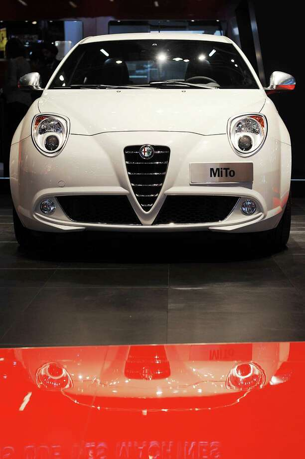 PARIS, FRANCE - SEPTEMBER 27:  An Alfa Romeo Mito car sits on display at the Paris Motor Show on September 27, 2012 in Paris, France. The Paris Motor Show runs September 29 - October 14. Photo: Antoine Antoniol, Getty Images / 2012 Getty Images