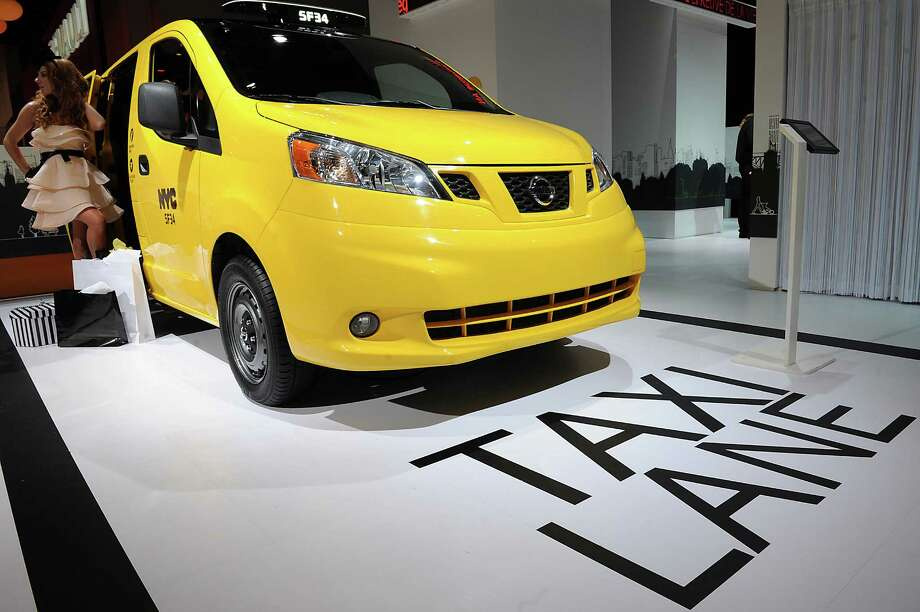 PARIS, FRANCE - SEPTEMBER 27:  A Nissan NV200 Taxi sits on display at the Paris Motor Show on September 27, 2012 in Paris, France. The Paris Motor Show runs September 29 - October 14. Photo: Antoine Antoniol, Getty Images / 2012 Getty Images