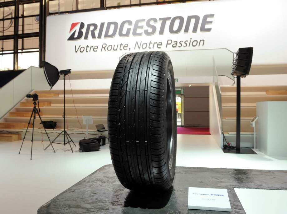 A Bridgestone tire is displayed at the Paris Motor Show on Sept. 27, 2012. Photo: AFP, AFP/Getty Images / 2012 AFP