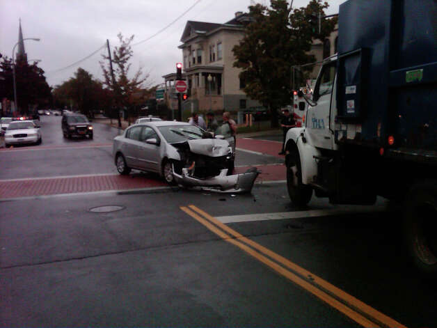 A Troy police car collided with another vehicle on Friday, Sept. 28, 2012, at the intersection of Ferry Street and Fifth Avenue in Troy. A Troy Housing Authority vehicle also was damaged in the crash. (Troy Police Department photo)