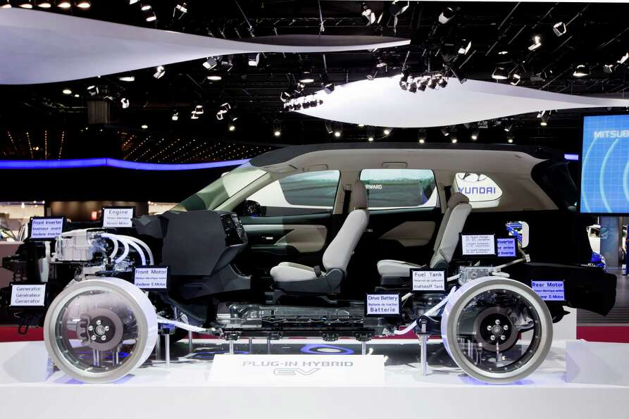 A Mitsubishi hybrid EV5 is displayed during the press days of the Paris Motor Show on Sept. 28, 2012