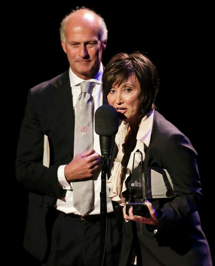 Country music star Pam Tillis and Italian bluegrass musician Martino Coppo, left, accept the guitar player of the year award on behalf of the late Doc Watson at the International Bluegrass Music Association Awards show on Thursday, Sept. 27, 2012, in Nashville, Tenn. (AP Photo/Mark Humphrey) Photo: Mark Humphrey