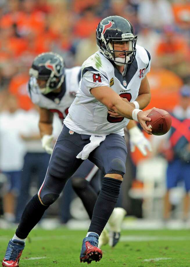 Houston Texans quarterback Matt Schaub hands off against the Denver Broncos during an NFL football game Sunday, Sept. 23, 2012, in Denver. (AP Photo/Jack Dempsey) Photo: Jack Dempsey, Associated Press / FR42408 AP