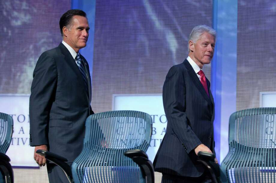 GOP presidential candidate Mitt Romney (left) needs a more coherent  message — as former President Bill Clinton, a political pro, could  devise — to win in November. Photo: Evan Vucci, Associated Press / AP