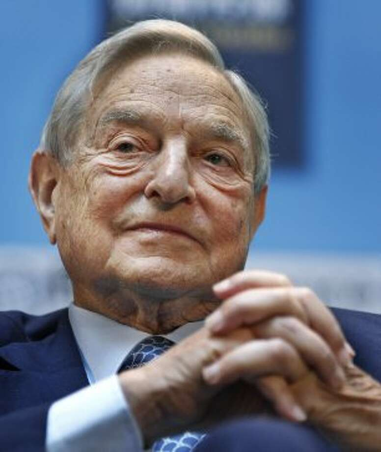 FILE - In this Sept. 24, 2010 file photo, George Soros, chairman of Soros Fund Management, speaks at the IMF/World Bank annual meetings in Washington. The smart money is split on Bank of America. Big hedge fund investors George Soros and John Paulson (not shown) are selling shares of Bank of America.  (Manuel Balce Ceneta / Associated Press)