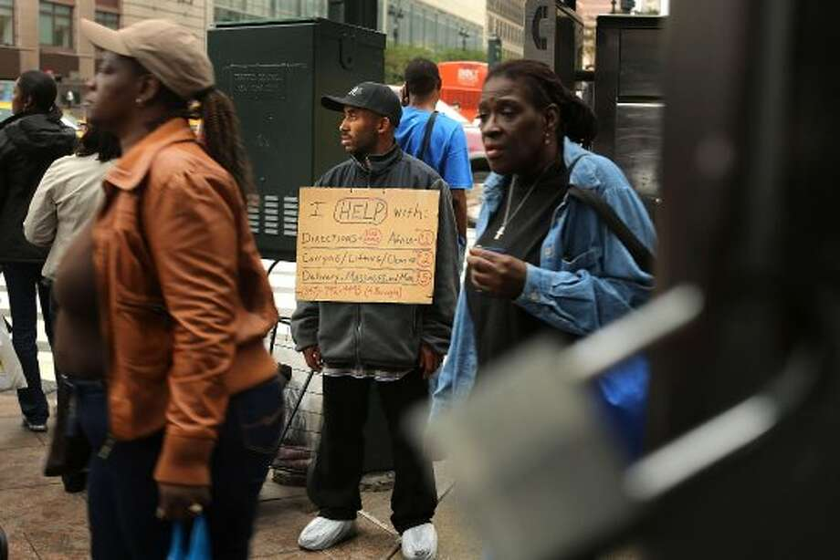 NEW YORK, NY - SEPTEMBER 28: Quan Flood, who says he is currently without a home, tries to pick up small jobs on a street corner in Manhattan on September 28, 2012 in New York City. In response to an increase in New York's homeless population, Mayor Michael Bloomberg's administration plans to open at least five new shelters by the end of this year. Currently the citywide shelter population is 46,036, including 26,503 adults and 19,537 children, which represents a 29% increase since spring 2011. The numbers of New Yorkers counted as homeless have surged after the city ended a rent-subsidy program known as Advantage.  (Spencer Platt / Getty Images)