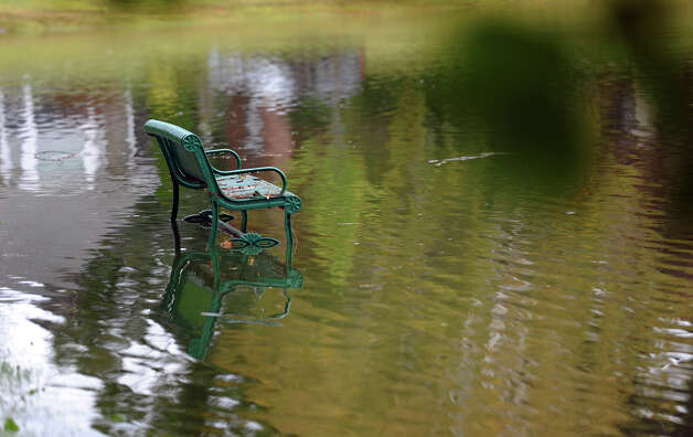 A bench at Brewsters Pond becomes inundated after heavy rains in Stratford, Conn. on Friday September 28, 2012. Photo: Christian Abraham / Connecticut Post