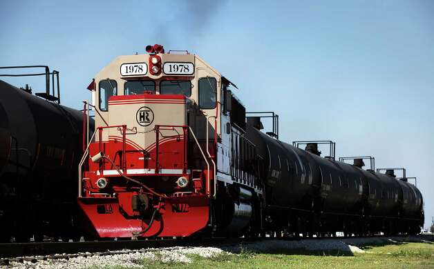 One of two engines owned by Hondo Railway pulls tanker cars in the yard.  The company has seen growth with the increased business from the Eagle Ford Shale oil production in south Texas.  Thursday, Sept. 20, 2012. Photo: BOB OWEN, San Antonio Express-News / © 2012 San Antonio Express-News