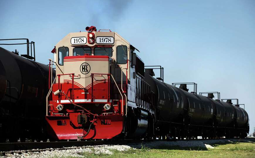 One of two engines owned by Hondo Railway pulls tanker cars in the yard.  The company has seen growt