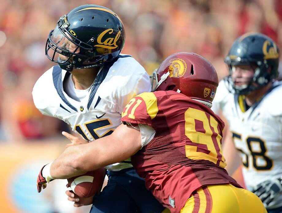 LOS ANGELES, CA - SEPTEMBER 22:  Zach Maynard #15 of the California Golden Bears is sacked by Morgan Breslin #91 of the USC Trojans during the second quarter at Los Angeles Memorial Coliseum on September 22, 2012 in Los Angeles, California.  (Photo by Harry How/Getty Images) Photo: Harry How, Getty Images
