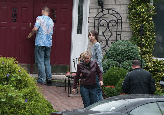 Visitors arrive at the home of Jeffrey Giuliano in New Fairfield, Conn., Friday, Sept. 28, 2012. Giuliano fatally shot a masked teenager in self-defense during what appeared to be an attempted burglary early Thursday morning, then discovered that he had killed his son, state police said.  (AP Photo/Jessica Hill) Photo: Jessica Hill, Associated Press / Associated Press