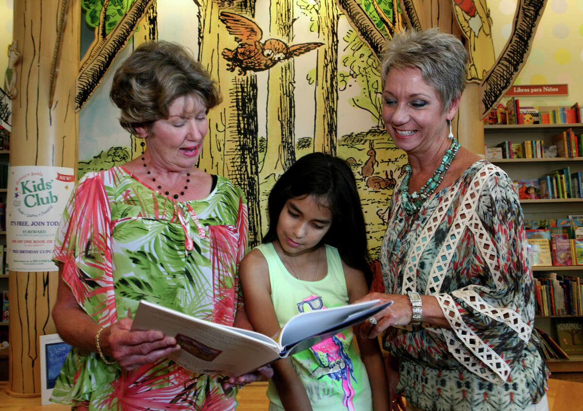 Author Linda Gilleland (from left), guest Bianca Acosta and illustrator Leigh Ann Irish gather during the reading and signing of Gilleland's book