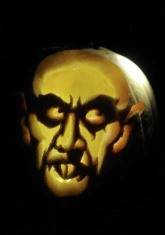 FEMHORROR102609  Brittni Hayes carved Nosferatu out of a Pumpkin. Nosferatu is a German Expressionist vampire horror film from the early 1920's.  Guiseppe Barranco/The Enterprise Photo: Guiseppe Barranco / Beaumont