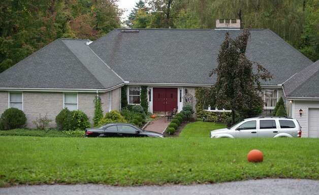 The home of Jeffrey Giuliano is scene here in New Fairfield, Conn., Friday, Sept. 28, 2012. Giuliano fatally shot a masked teenager in self-defense during what appeared to be an attempted burglary early Thursday morning, then discovered that he had killed his son, state police said. (AP Photo/Jessica Hill) Photo: Jessica Hill, Associated Press / FR125654 AP