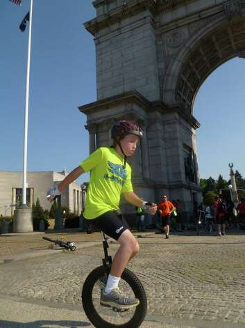 Danbury resident Elijah Crehan,10, unicycles in the NYC Unicycling Festival. Photo: Contributed Photo