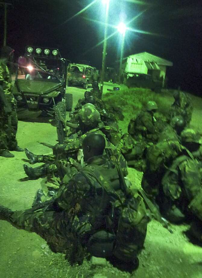 This undated photo provided by Kenya's Ministry for Defence on Friday, Sept. 28, 2012, is said by them to show Kenya Defence Forces troops at an undisclosed location in Kenya, engaged in recent preparations for an assault on the Somali port city of Kismayo. Kenyan troops invaded al-Shabab's last stronghold in Somalia on Friday, coming ashore in a predawn beach landing at Kismayo that appeared likely to deprive the Islamist insurgents of their last big money-making enterprise. (AP Photo/Kenya Ministry for Defense) Photo: Associated Press