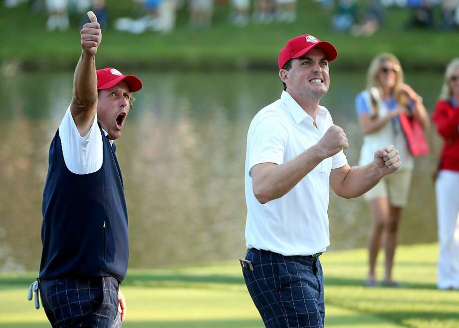 Phil Mickelson (left) and Keegan Bradley of the United States celebrate on the 17th green after defeating  Rory McIlroy and Graeme McDowell. Photo: Andrew Redington, Getty Images
