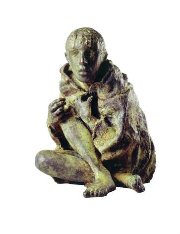 """The Victim,"" a bronze cast in 1998 by Rowan Gillespie, is the first piece acquired by Ireland's Great Hunger Museum at Quinnipiac University. It represents ""each one of the millions who died from starvation or disease, or emigrated. The scale of the figure (which can be measured in inches) is in direct contrast to the scale of the horror."" The museum opens to the public on Oct. 11, 2012. Photo: Contributed Photo"