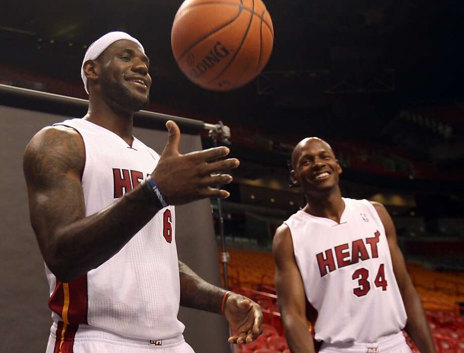 New teammates LeBron James (left) and Ray Allen wait to have their photos taken. Photo: Wilfredo Lee, Associated Press