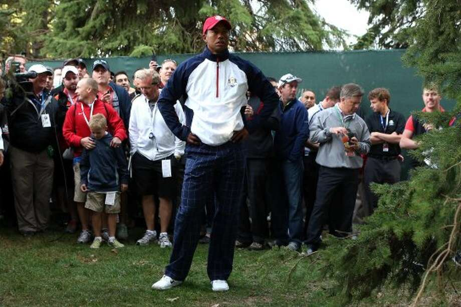 Tiger Woods of the USA look for a shot from the rough on the first hole during the Morning Foursome Matches for The 39th Ryder Cup at Medinah Country Club on September 28, 2012 in Medinah, Illinois. (Andy Lyons / Getty Images)