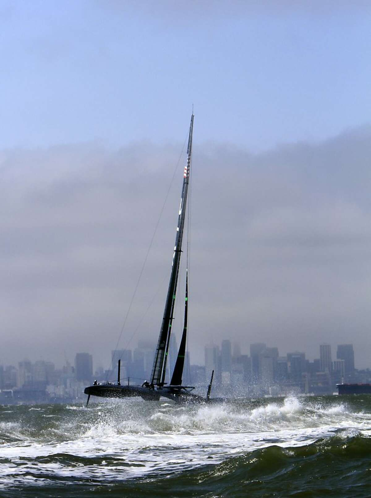 The Oracle team takes the AC72, a new 72-foot catamaran, out for its third test on the water in the bay in San Francisco, Calif., Friday, September 28, 2012.