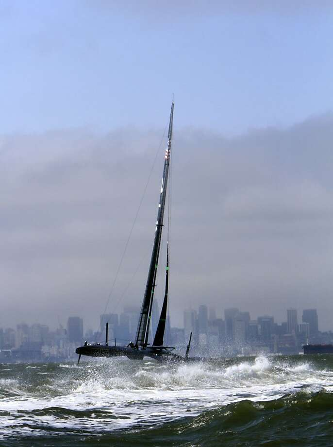 Team Oracle Racing takes its massive AC72 catamaran that can run faster than the wind out for one of the boat's first test runs. Photo: Sarah Rice, Special To The Chronicle