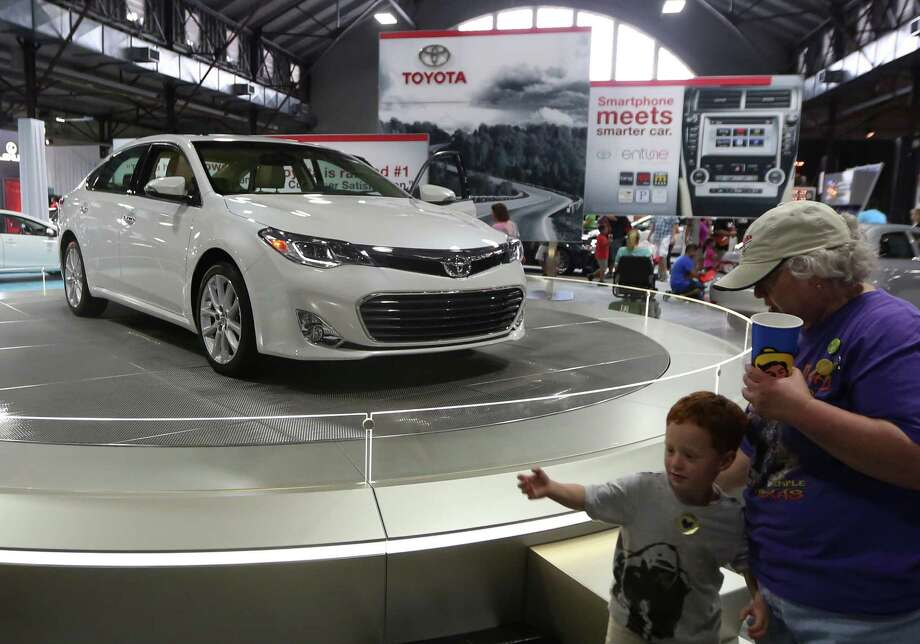 The 2013 Toyota Avalon sits on display in the auto pavilion during the State Fair of Texas, Friday, Sept. 28, 2012, in Dallas. (AP Photo/LM Otero) Photo: LM Otero, Associated Press / AP