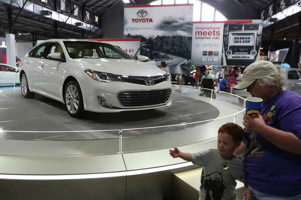 The 2013 Toyota Avalon sits on display in the auto pavilion during the State Fair of Texas, Friday, Sept. 28, 2012, in Dallas. (AP Photo/LM Otero)