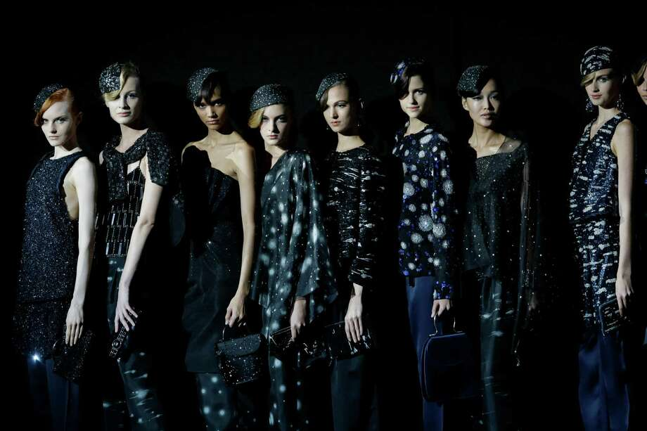 Model wear creations as part of the Giorgio Armani collection. Photo: Luca Bruno, ASSOCIATED PRESS / AP2012