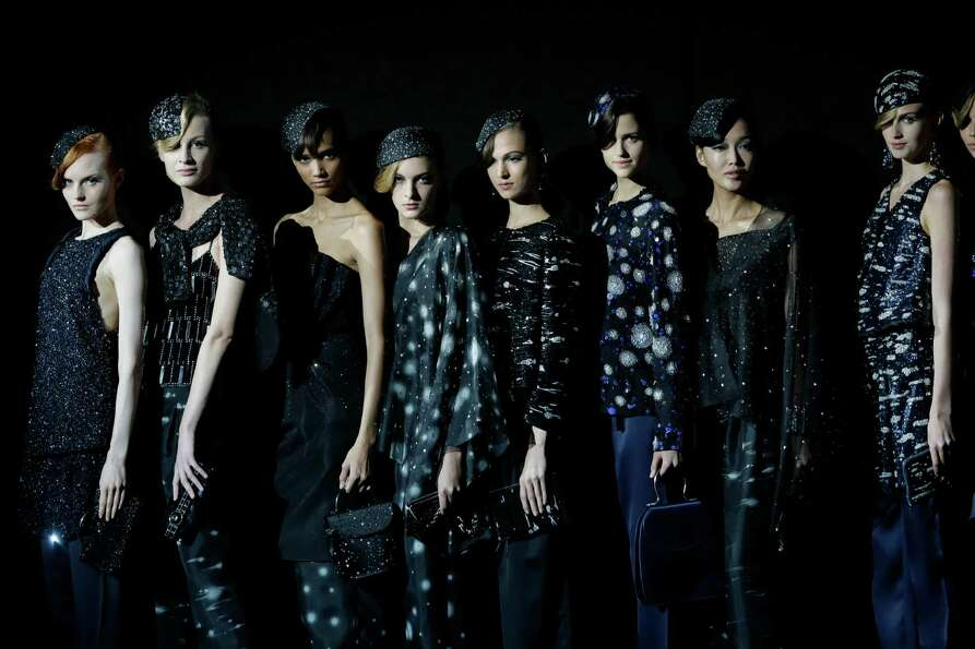 Model wear creations as part of the Giorgio Armani collection.