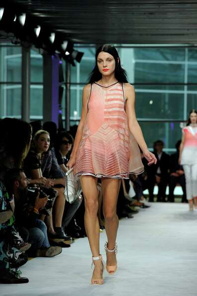 A model wears a creation as part of the Missoni collection.