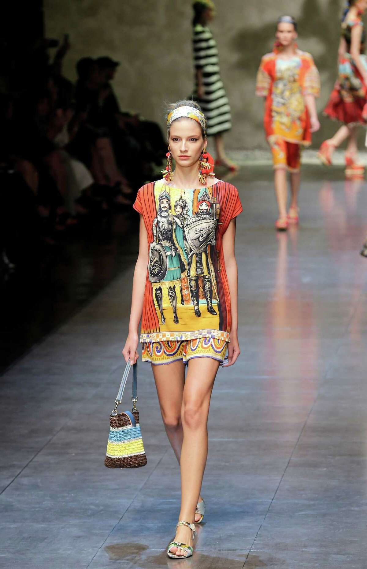 A model wears a creation as part of the Dolce & Gabbana women's spring/summer 2013 fashion collection, during Milan Fashion Week in Milan, Italy. This year's event ran Sept. 19-25.