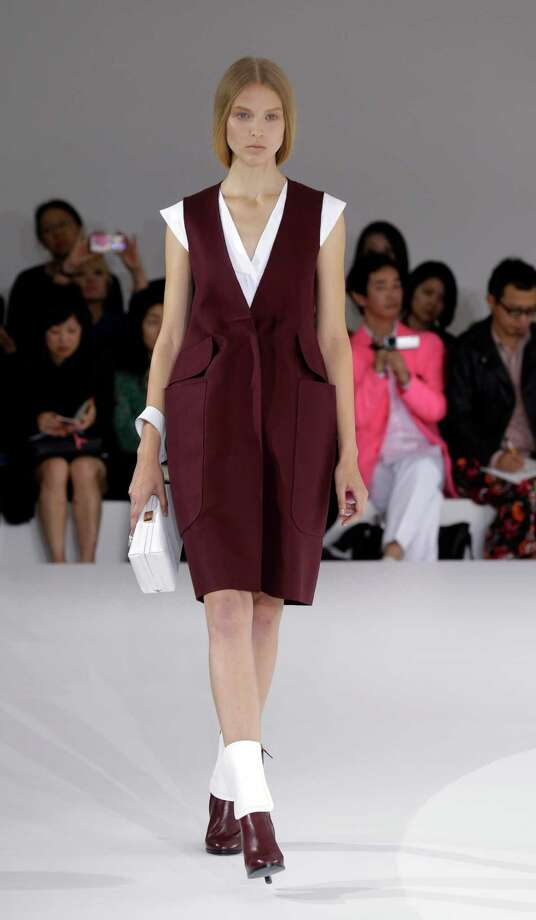 A model wears a creation as part of the Jil Sander collection. Photo: Luca Bruno, ASSOCIATED PRESS / AP2012