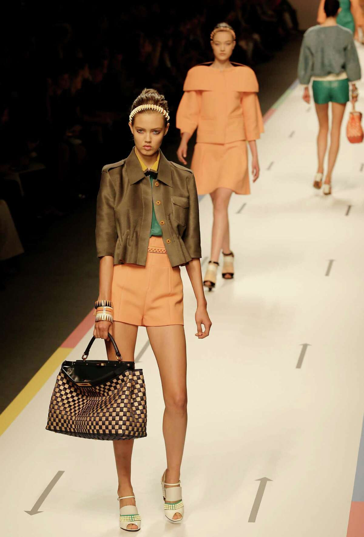 Models wear creations as part of the Fendi collection.