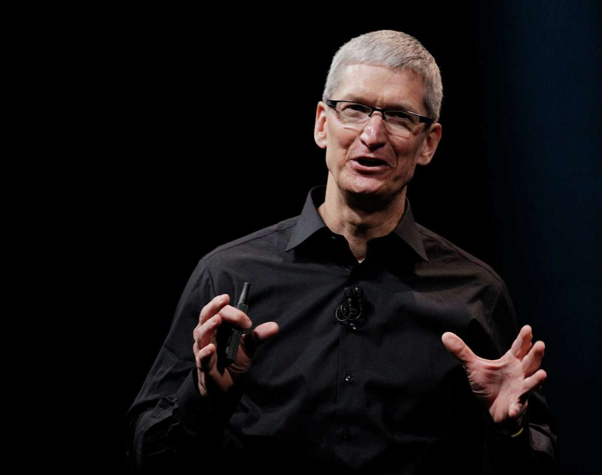 In this Wednesday, Sept. 12, 2012 photo, Apple CEO Tim Cook speaks during an introduction of the new iPhone 5 in San Francisco. (AP Photo/Eric Risberg)