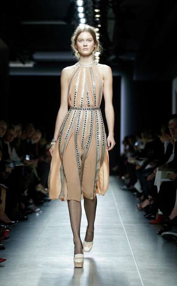 A model wears a creation as part of the Bottega Veneta collection. Photo: AP