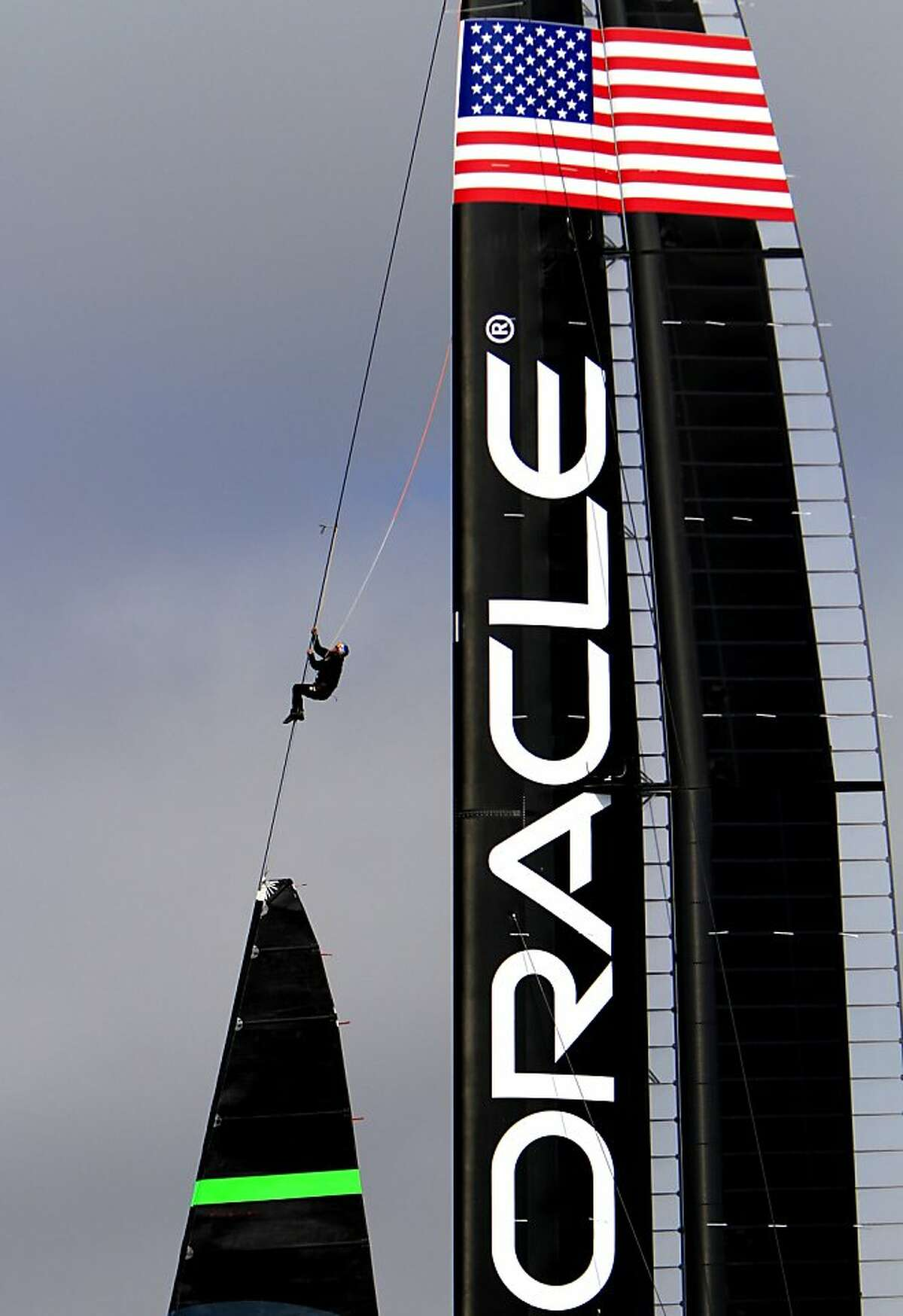 The Oracle team changes the sails while taking the new AC72 out for a test run in the bay in San Francisco, Calif., Friday, September 28, 2012.