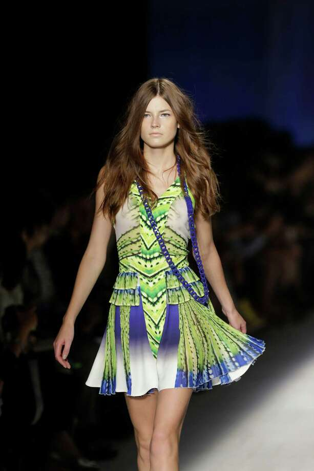 A model wears a creation as part of the Just Cavalli collection. Photo: AP