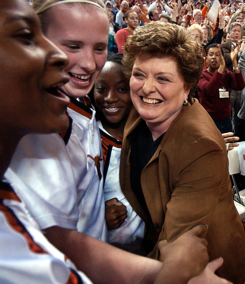 Jody Conradt, right, celebrates her 800th win Jan. 22, 2003. Her time at UT also included coaching the sport's first undefeated national champion. Photo: DEBORAH CANNON / AP