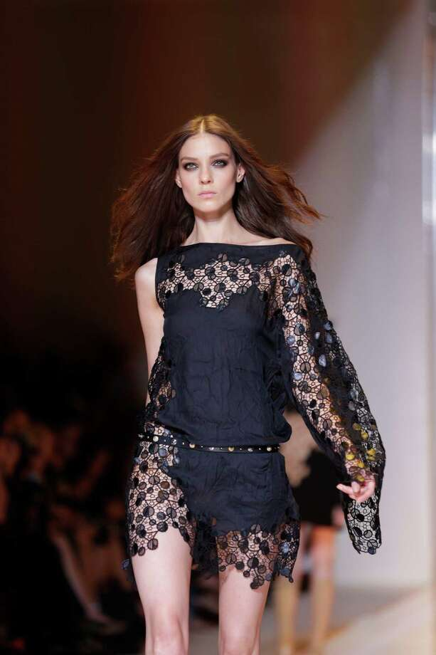 A model wears a creation as part of the Versace collection. Photo: AP
