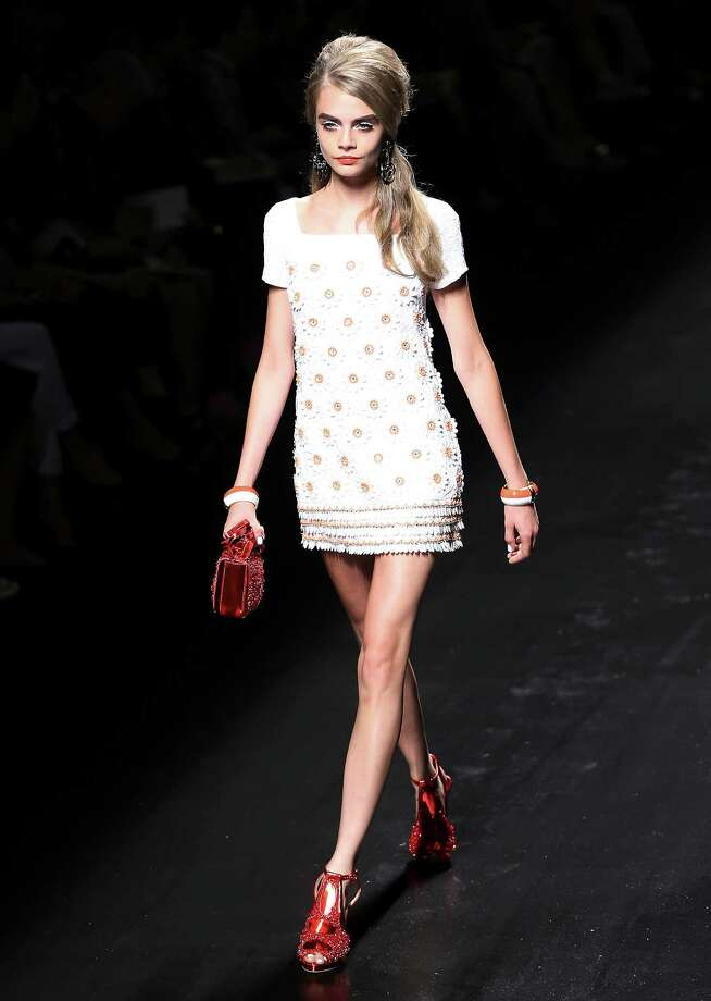 A model wears a creation as part of the Moschino collection. Photo: AP
