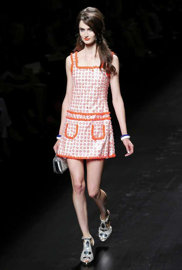 A model wears a creation as part of the Moschino collection. Photo: Antonio Calanni, ASSOCIATED PRESS / AP2012