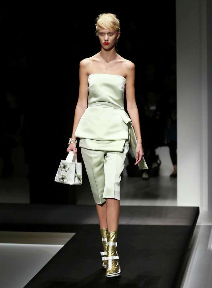 A model wears a creation as part of the Prada collection. Photo: AP